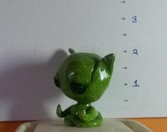 Meditating green alien
