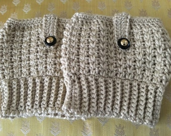 Beige boot cuffs with black and brass detail