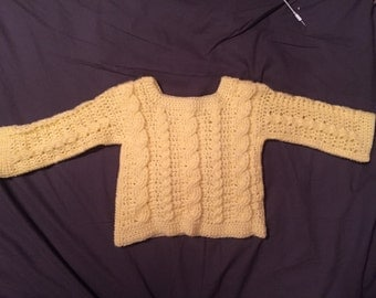 baby sweater made in crochet cables