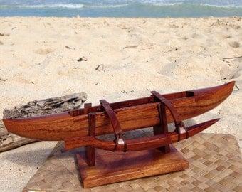 Handmade Koa canoes and crosses