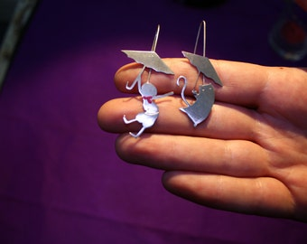 Flying on the sky. Special earrings from silver 925