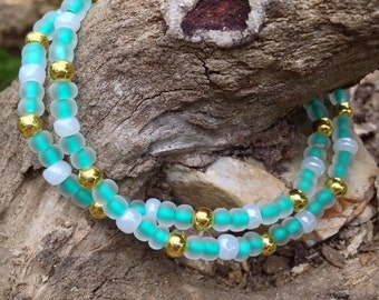 Turquoise and gold beaded bracelet with iridescent accents