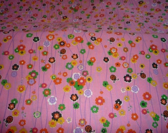 Cotton pink with flowers and ladybugs