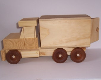 Handmade wooden toy delivery truck.