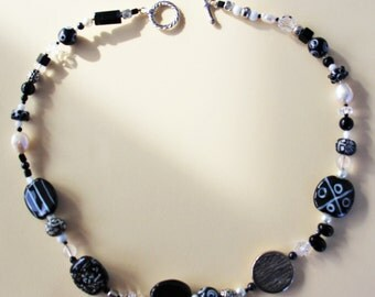 Kazuri bead necklace, black and white with silver tone toggle
