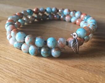 Bohemian wrap bracelet with silver charm