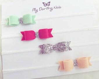 Set of 4 mini bows 100% Quality Wool felt and nylon elastic