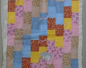 D101 & D102 - Two doll quilts in pastel colors. Each has an ironed-on bunny applique.