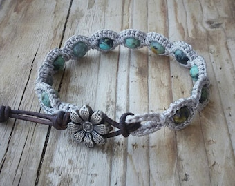 Crocheted bracelet with african turquoise beads~real leather cord~metal flower button