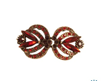 Red and golden toggle buckle brooch