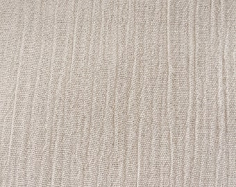 Slightly pleated cream cotton fabric
