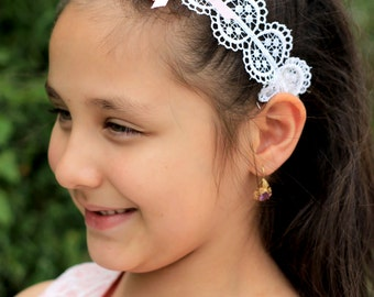 Little Girl's Ivory Lace Headband features small pink satin ribbon with two small pearls.