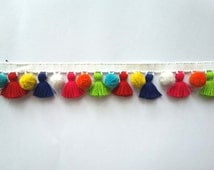 Multi coloured tassel fringe with pom pom trims
