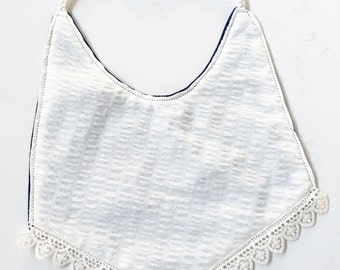 The reversible Boho bib is so soft that it will ad a touch of elegance to any onsie.