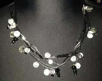 Crystal/pearl/bead accented multi strand ribbon necklaces