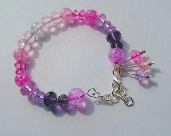 Pink and purple beaded bracelet.