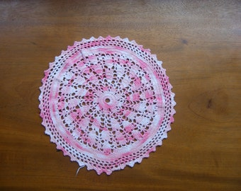 Hand crocheted round doily for sale.