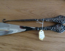 silver shoe horn and hook