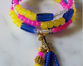 Pink, yellow and cobalt blue Czech glass beaded memory wire braclet, with  dangling beaded tassel and beaded charm.