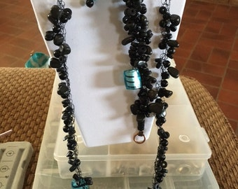 6 black and blue with some wood and some glass beads
