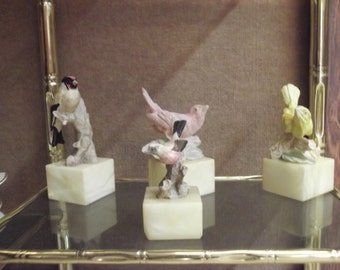 Figures of four different breeds birds, in resin