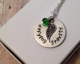 """Wicked the Musical inspired """"defying gravity"""" necklace - hand stamped, with wing and bead charms."""
