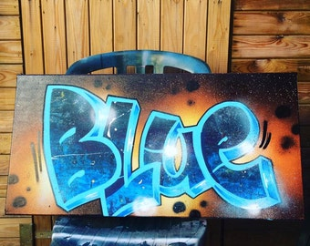 icy blue space graffiti canvas