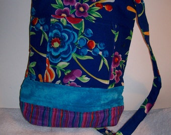 Tropical flowers tablet bag.  Glorious orange, purple and turqoise print with deep blue background  tech bag.  ip204