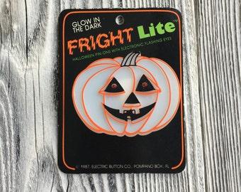 Vintage glow in the dark Halloween light up pumpkin pin, vintage Halloween pin,