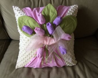 White decorative 18x18 pillow with bouquet of tulips