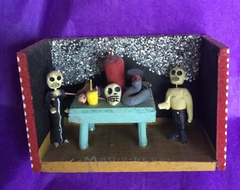 Day of the Dead figures in a wooden box