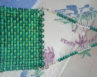 bag 1960 s has green pearls!