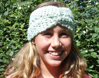 Green Boucle hair band/hat-size 10/12 years