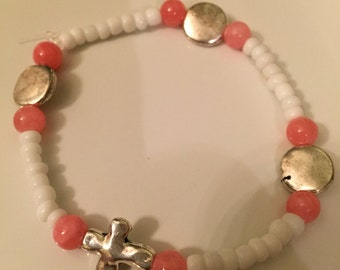 Cute pink/white beaded bracelet with silver cross--size medium