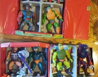 1984 He Man cases with 11 figures + mini comics.