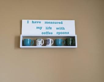Coffee/tea mug shelf with T.S. Eliot quote