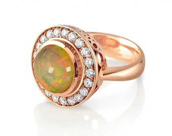 18ct rose gold cluster ring,round cabochon ethioipian opal surrounded by brilliant cut diamonds
