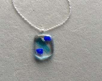 Blue and clear fused glass pendant