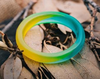 Translucent Yellow to Bluey-Green Resin Bangle.