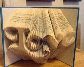 "Book Folding Art ""Love""...Makes a great gift for Weddings, Anniversaries, Housewarming and more"