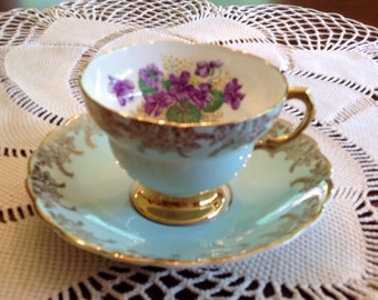1948-1952 Rosina teacup and saucer. Beautiful violets on aqua bone china trimmed with gold.