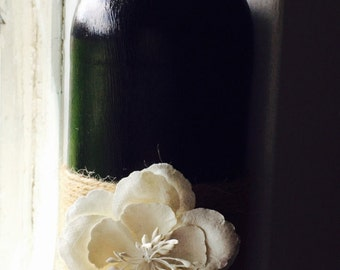 Black Painted Bottle with Hawiaan accent flower!