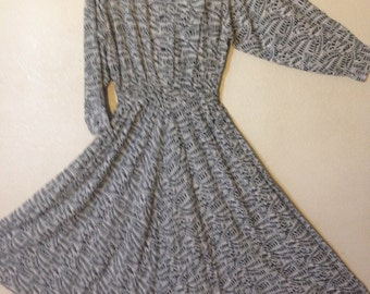 women gray white button up long sleeved flare dress