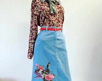 Blue knee length applique skirt