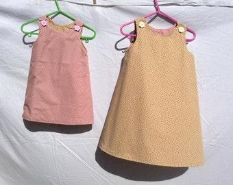 Pink star-print reversible dress
