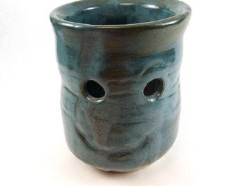 tourmaline green tea candle holder, stoneware glass with face, children's art