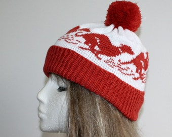 Rust red and white pompom beanie hat with racing Whippet or Grey Hound dogs