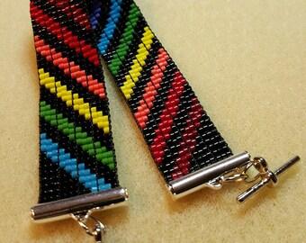 Rainbow stripes on black bead loom bracelet