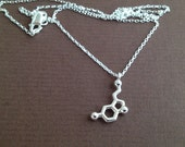 tiny serotonin necklace in solid sterling silver
