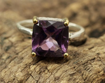 Purple Amethyst faceted gemstone in sterling silver ring